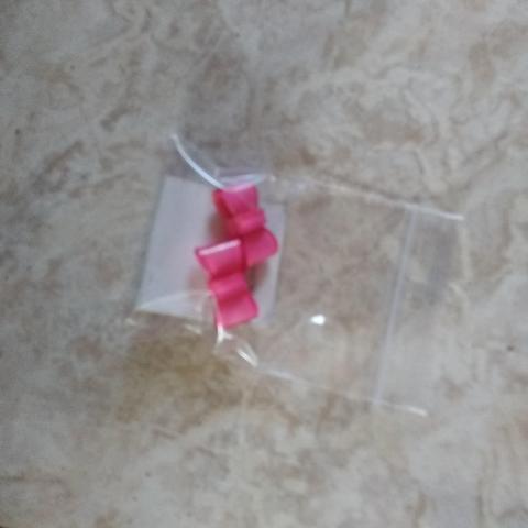 troc de  boucle d oreille noeud rose neuf, sur mytroc