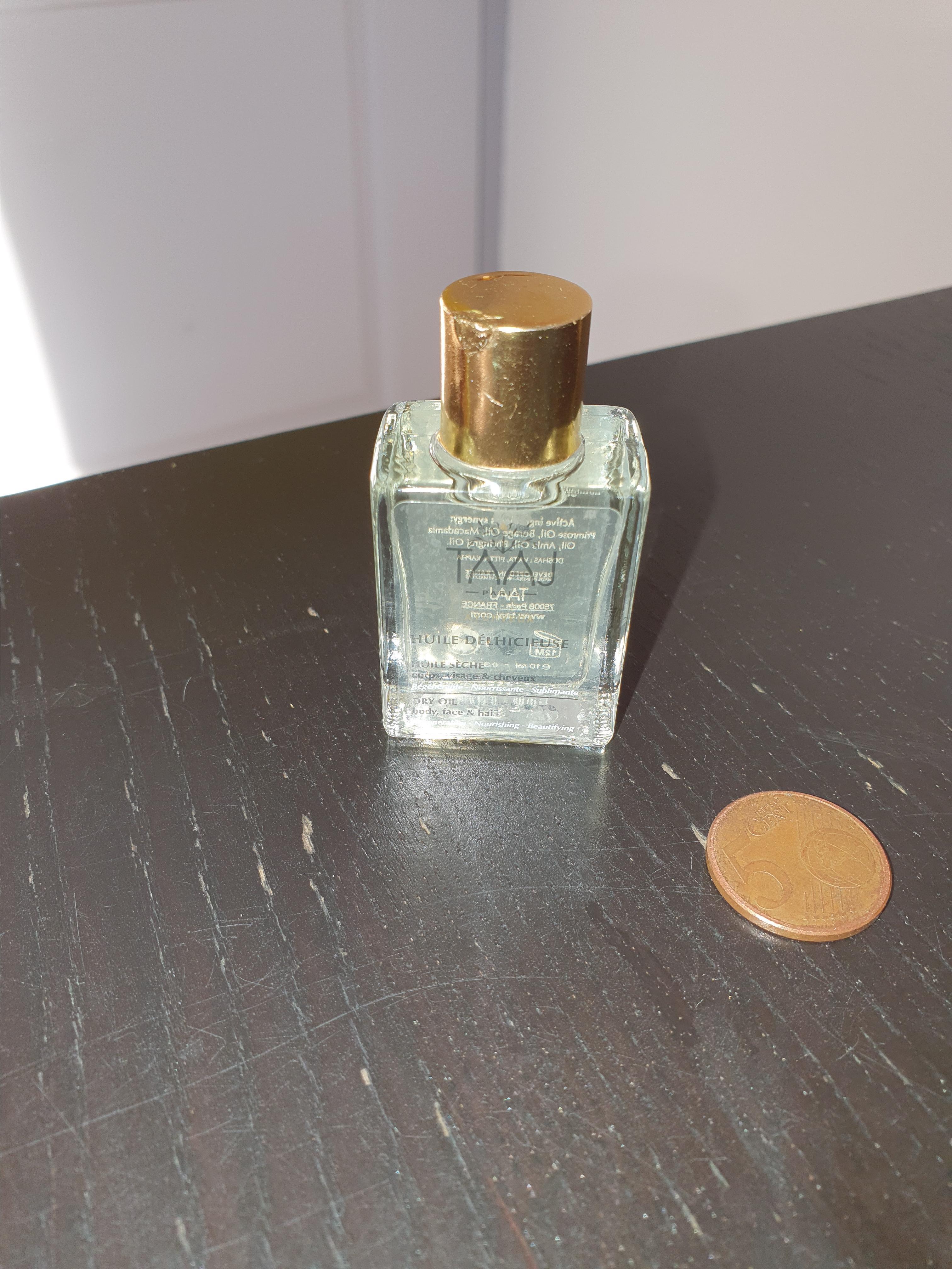 troc de troc petite bouteille d'huile délicieuse taaj image 0